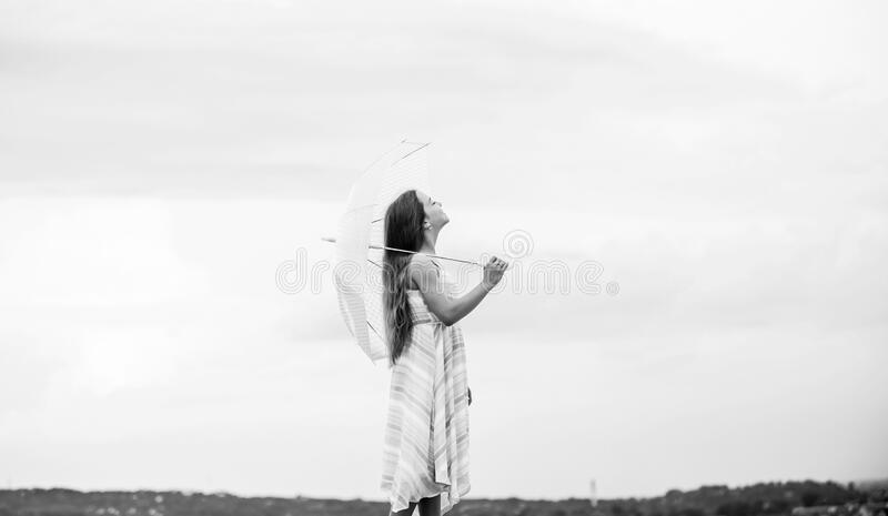 Fairy tale character. Happy childhood. I believe i can fly. Touch sky. Feeling light. Girl with light umbrella. Fly drop. Parachute. Anti gravitation. Dreaming royalty free stock images