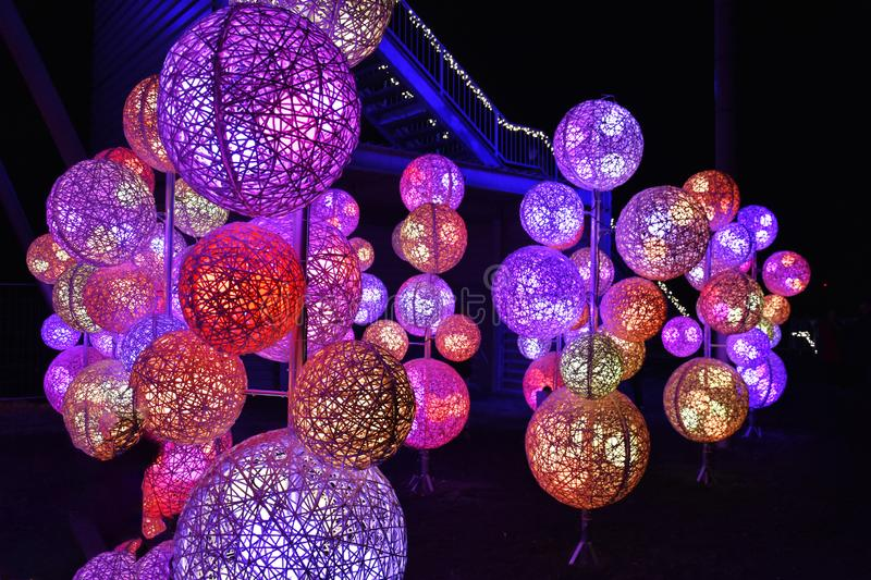 Fairy tale forest with colorful illumination. Illuminated balloons in a fairy tale forest at christmas time in Hückelhoven, a former mining town in Germany