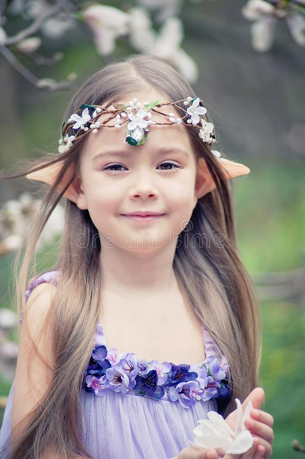 fairy tale girl. Portrait of mystic elf child. Cosplay character stock images