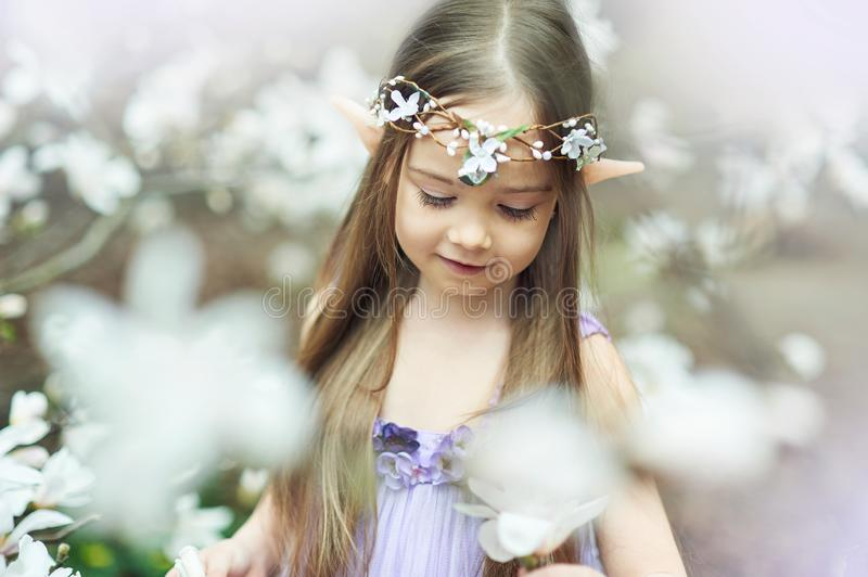 fairy tale girl. Portrait of mystic elf child. Cosplay character stock image