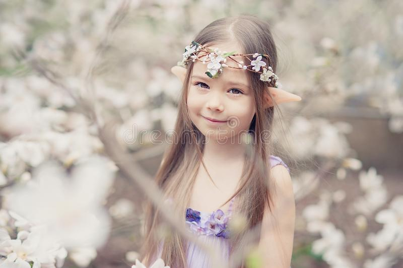 fairy tale girl. Portrait of mystic elf child. Cosplay character royalty free stock photography
