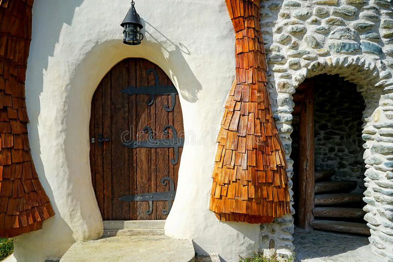 Fairy tale house. Detail, wooden door and spiral staircase royalty free stock photo