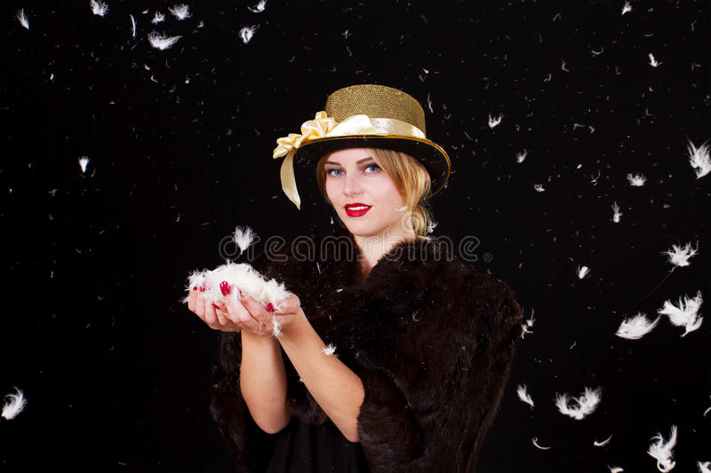 Fairy woman in feathers rain royalty free stock photos
