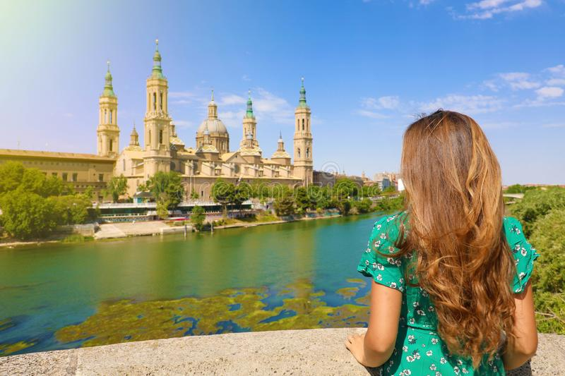 Fairy young woman with long hair back view on fairy landscape in Spain royalty free stock photos