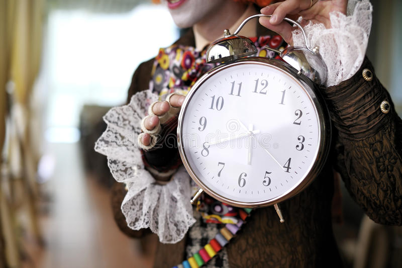Fairytale character holding an alarm clock. Fairytale character holding a giant alarm clock stock image