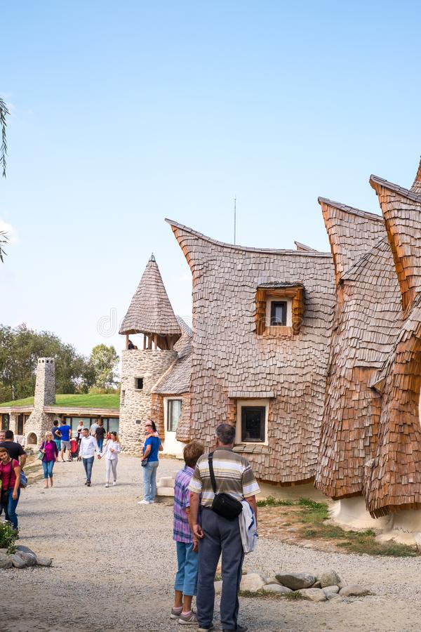 Fairytale clay castle of Porumbacu village. Porumbacu Village, Romania - 14 September 2019. people visiting Clay Castle of the Fairy Valley in Porumbacu de Sus royalty free stock photos