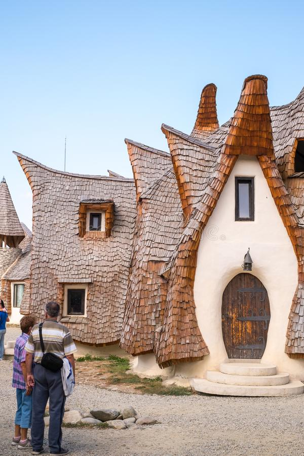 Fairytale clay castle of Porumbacu village. Porumbacu Village, Romania - 14 September 2019. people visiting Clay Castle of the Fairy Valley in Porumbacu de Sus stock photography