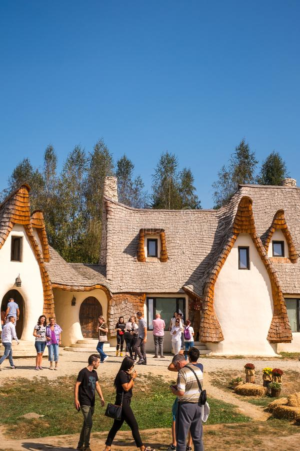 Fairytale clay castle of Porumbacu village. Porumbacu Village, Romania - 14 September 2019. people visiting Clay Castle of the Fairy Valley in Porumbacu de Sus royalty free stock image