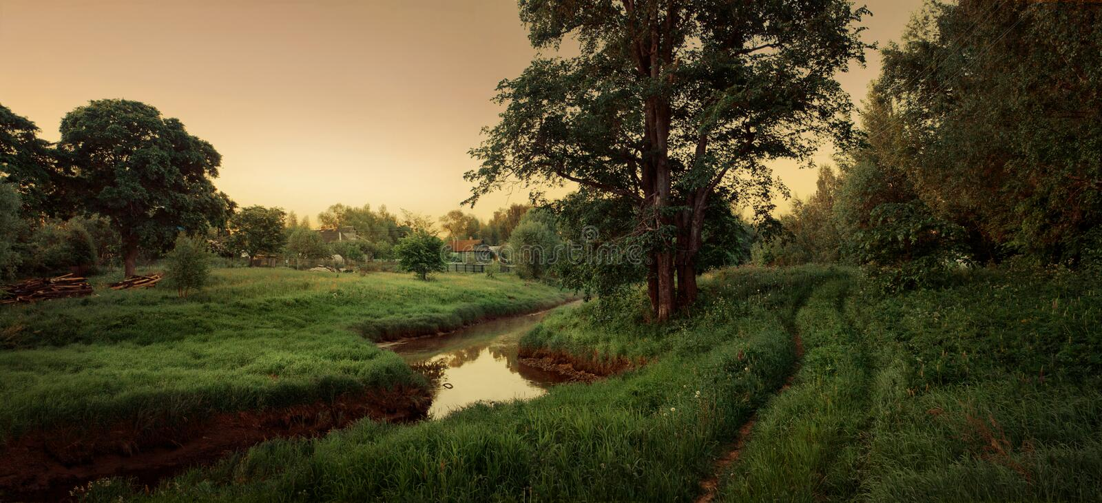 Fairytale village with river and road royalty free stock photos