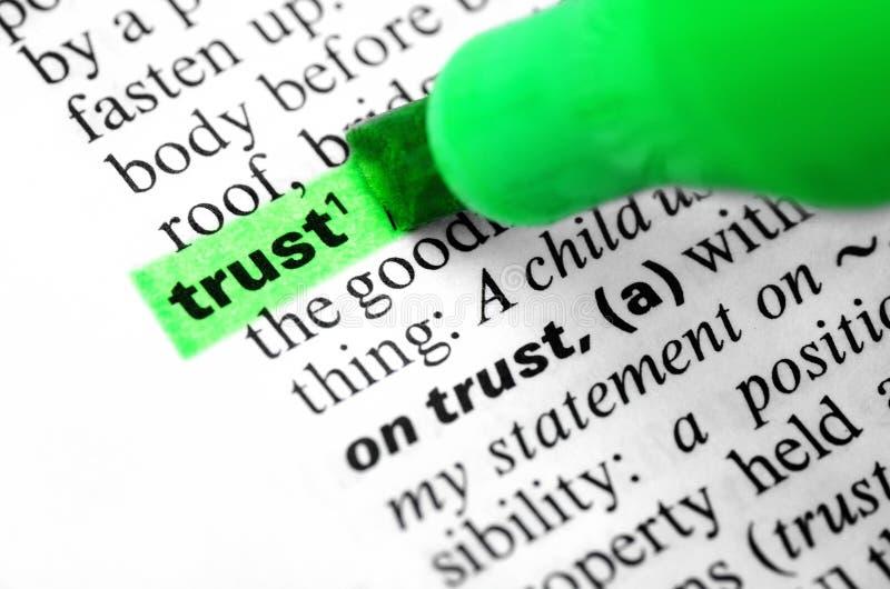 Faites confiance au mot dedans accentué en dictionnaire, affaires photos libres de droits