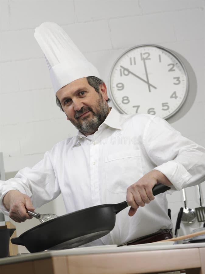 Faites cuire dans une cuisine photos libres de droits
