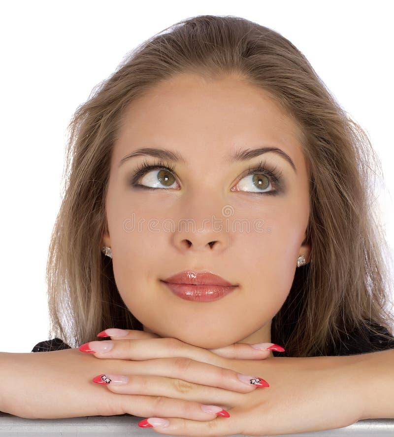 Faites face à la fin de la fille de portrait regardant sur le blanc photo libre de droits