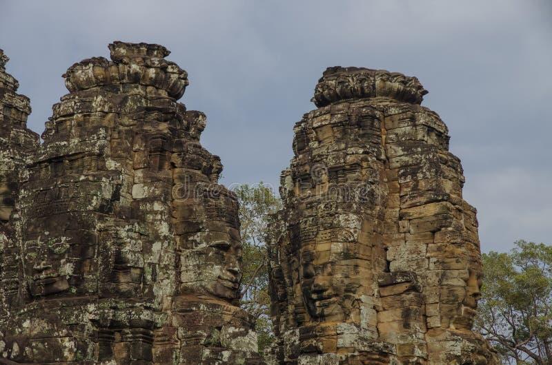 Faites face à la pierre du temple antique de Bayon dans Angkor Vat, Siem Reap, Cambodge photo stock