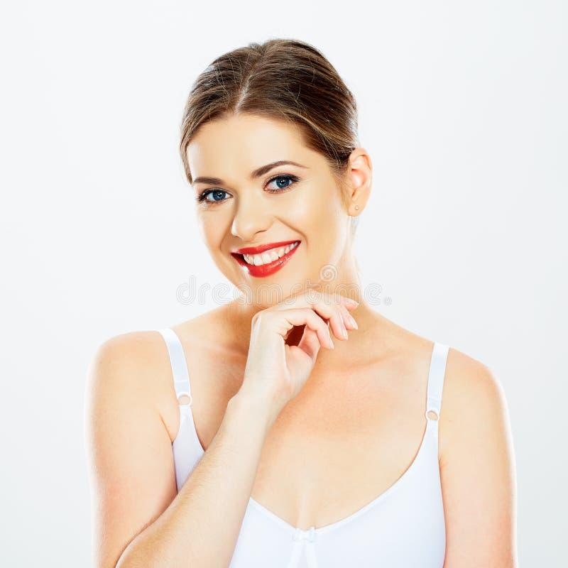 Faites face au portrait de la femme de sourire d'isolement sur le fond blanc photo libre de droits