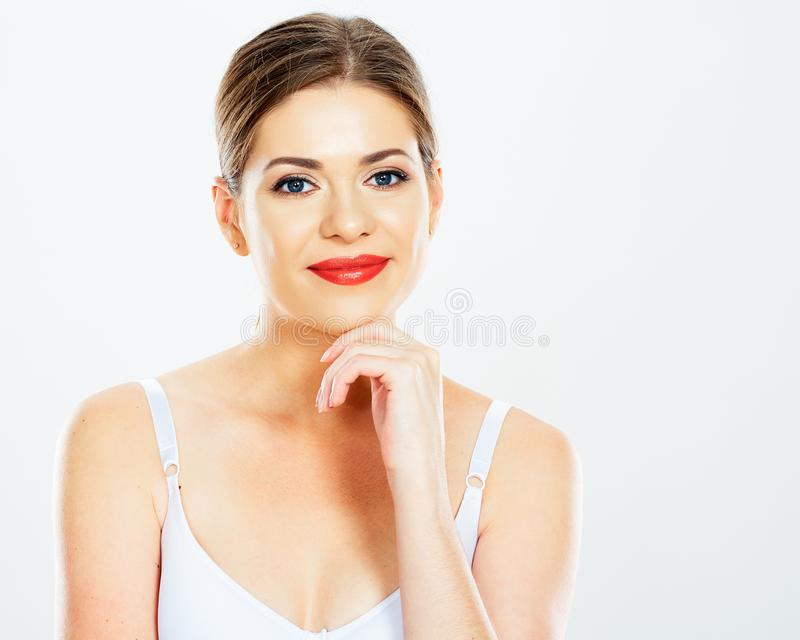 Faites face au portrait de la femme de sourire sur le fond blanc photos libres de droits