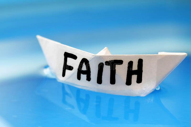 Faith. Paper boat on cyan background royalty free stock images
