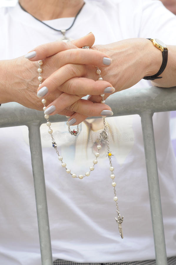 Faith - Older Female Hands In Prayer With Rosary Stock Photo