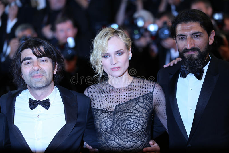 Faith Akin, Diane Kruger, Numan Acar. Attend the `In The Fade Aus Dem Nichts` premiere during the 70th Cannes Film Festival at Palais on May 26, 2017 in Cannes royalty free stock photo