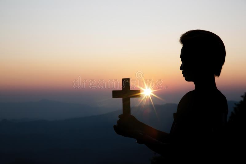 Spiritual prayer hands over sun shine with blurred beautiful sunset background. Faith of christian concept: Spiritual prayer hands over sun shine with blurred stock photos