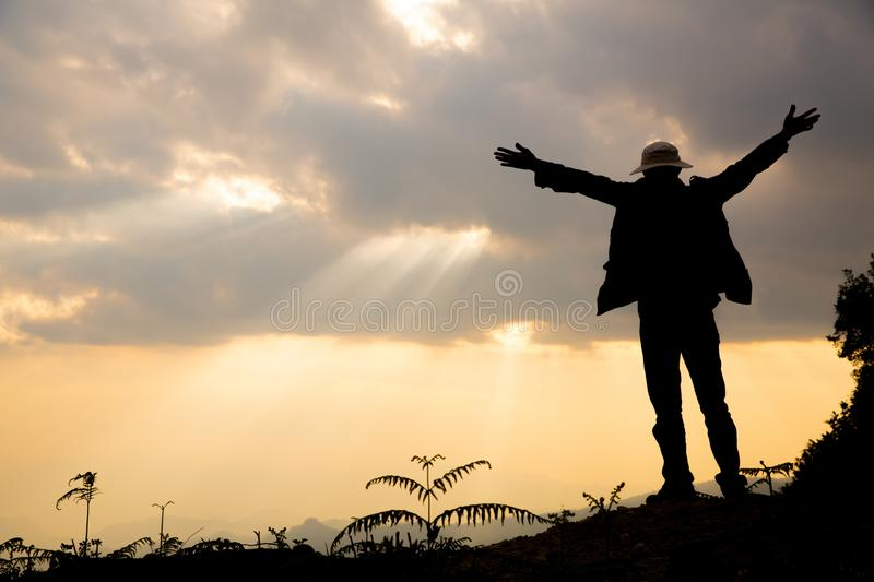 Faith of christian concept: Spiritual prayer hands over sun shine. With blurred beautiful sunset background stock photos
