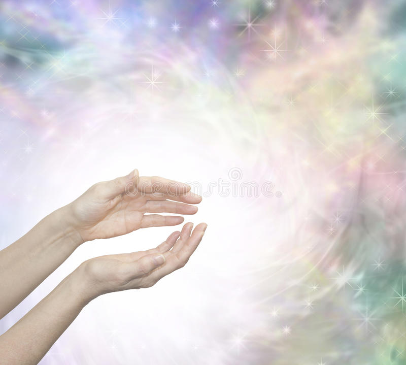 Faith Healing with Blissful Energy. Outstretched female healing hands surrounded by a large radiating circle of white light and a subtle pastel colored ethereal royalty free stock photos