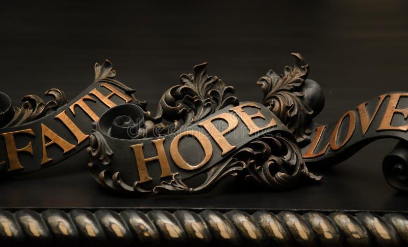 Faith Hope and Love. Faith, Hope and Love wall decor stock photos