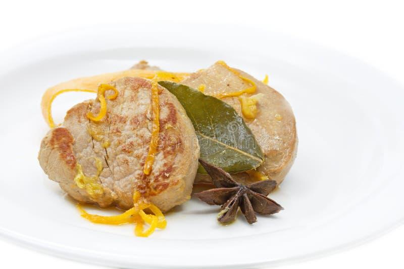 Faixa da carne de porco com molho alaranjado imagem de stock