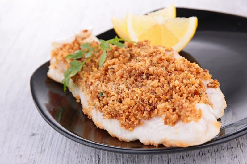 Faixa de peixes cozinhada com migalha fotografia de stock