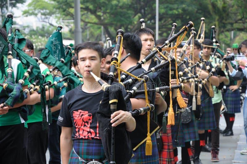 Faixa escocesa da música da tubulação do dia do ` s de St Patrick foto de stock royalty free