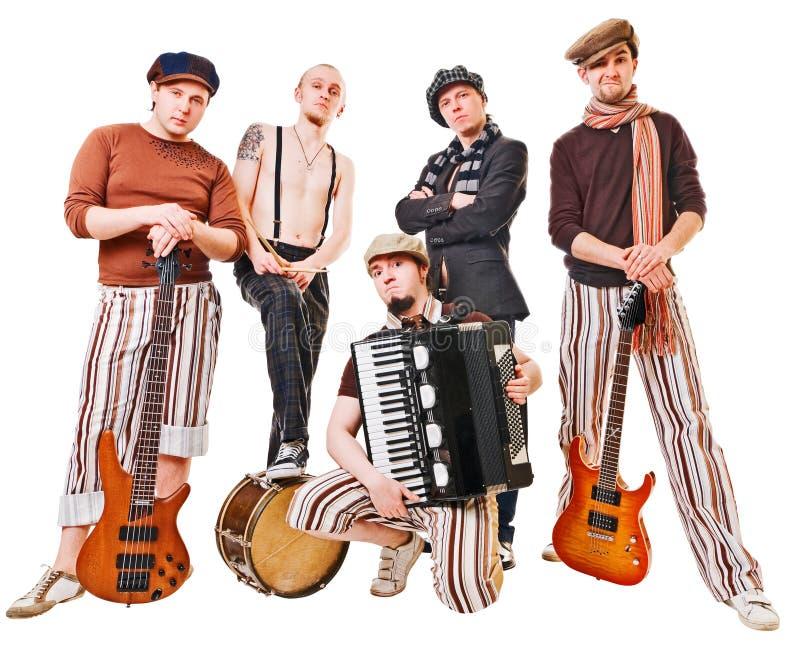 Faixa musical com seus instrumentos no branco foto de stock royalty free