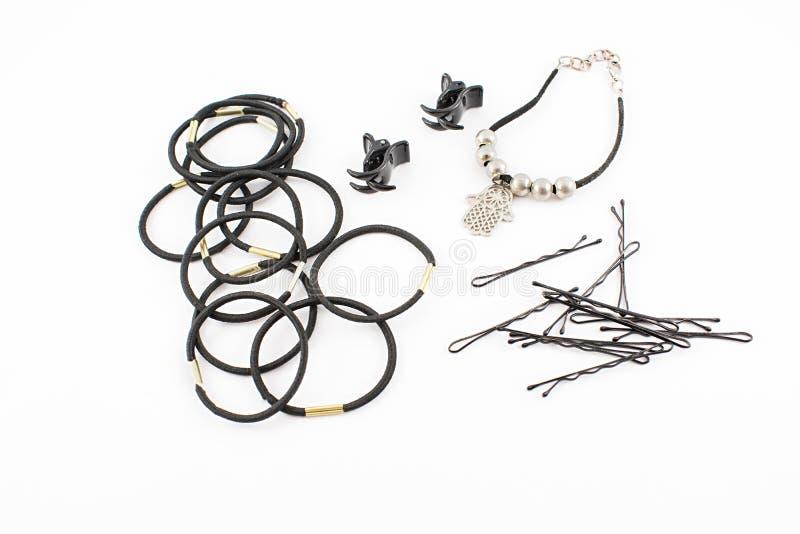 Faixas elásticas, grampos e invisível e bracelete imagens de stock