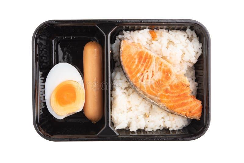 Faixas salmon Roasted com arroz Isolado em um fundo branco fotos de stock royalty free