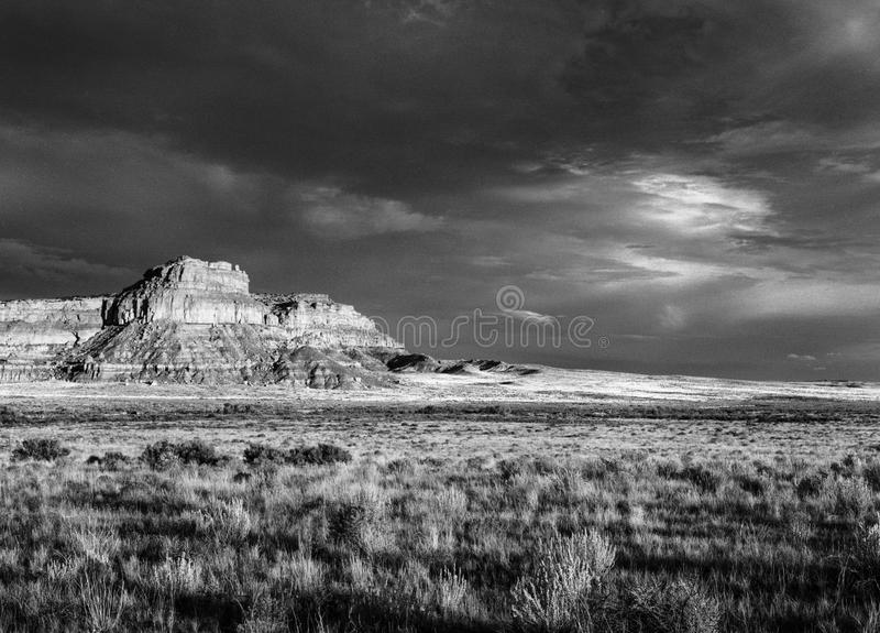 Fajada Butte, Chaco Canyon, New Mexico. Chaco Butte stands had the head of chaco canyon in central New Mexico - seen here with a rising thunderstorm to the south stock photo