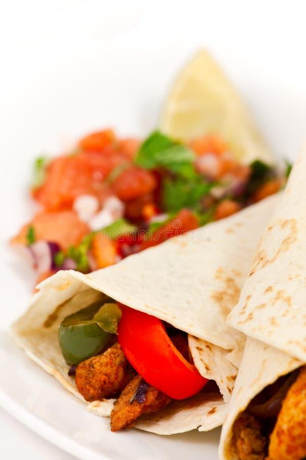 Fajita wraps with peppers and salsa stock photo