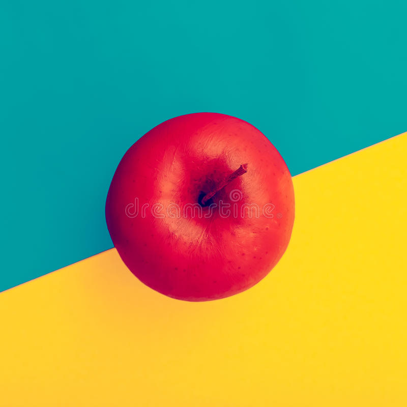 Fake Apple in red paint. minimal style.  stock photo