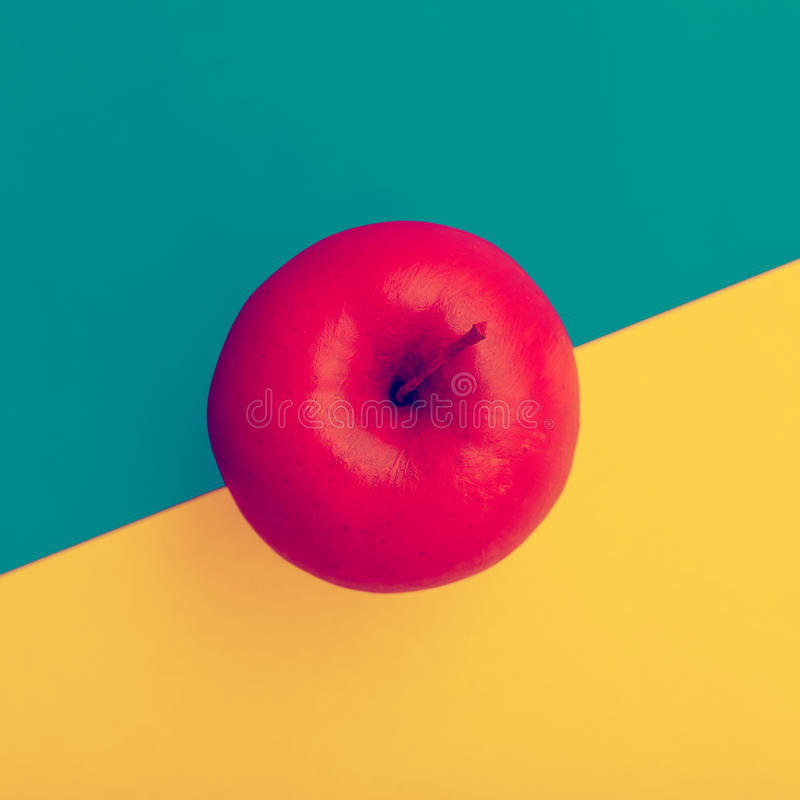Fake Apple in red paint. minimal style.  stock photos