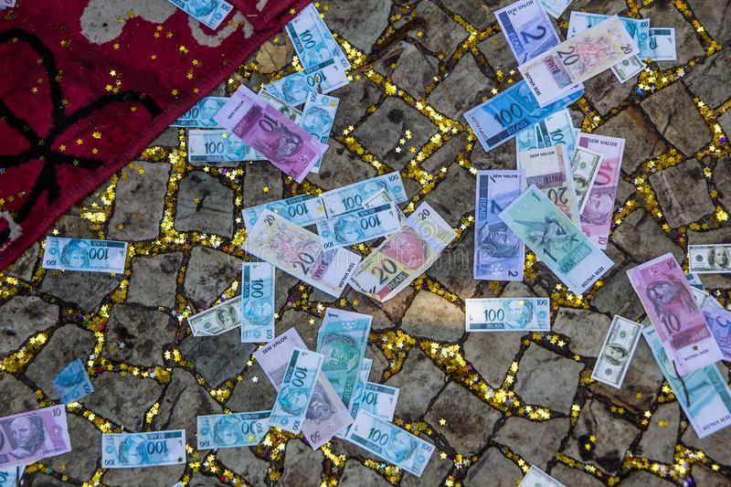 Fake brazilian money & x28;real& x29; on the floor. With star shaped paper as well stock photo
