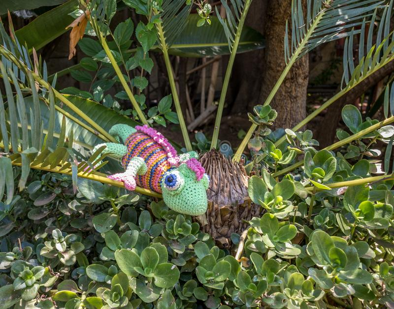 A fake chameleon in a shrub stock photography