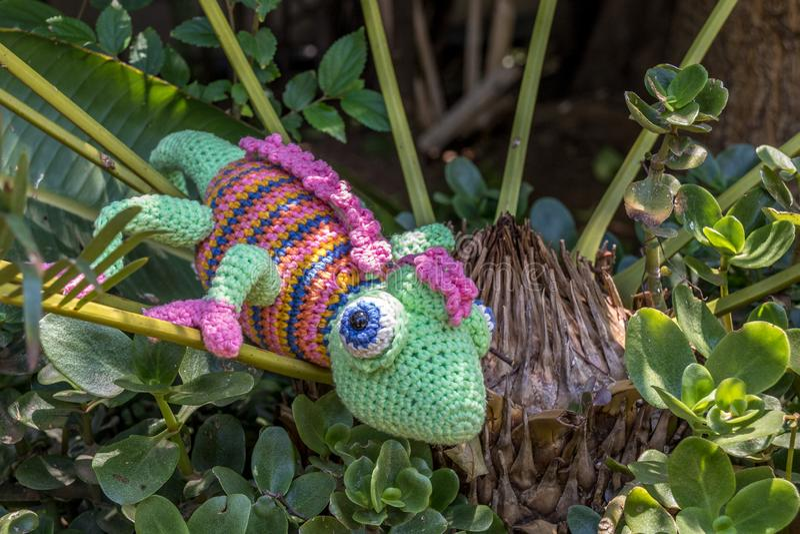 A fake chameleon in a shrub royalty free stock photos
