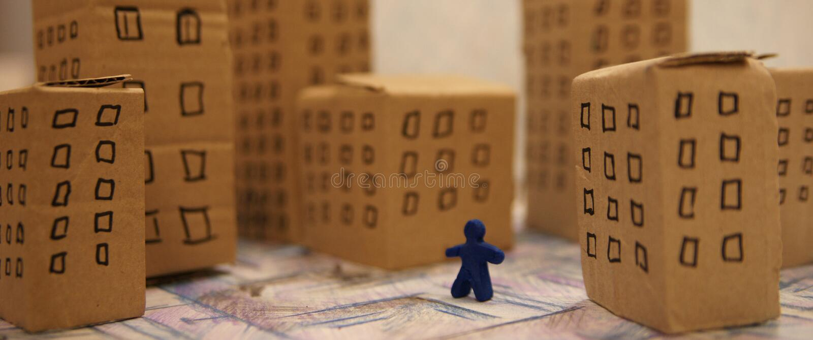 Fake city detail. Cardboard houses and toy figure stock photography