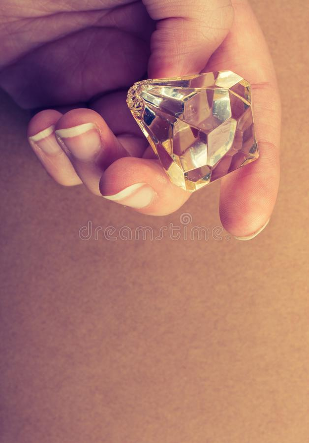 Fake diamond stone in hand stock images