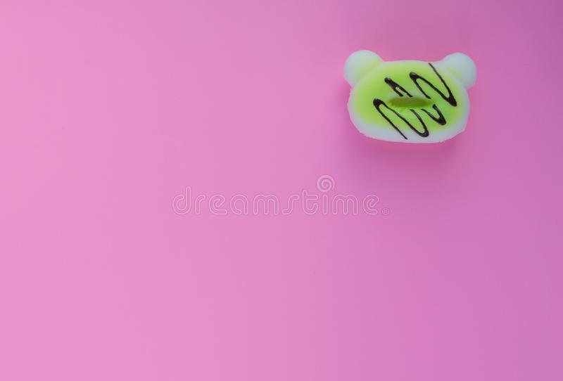 Fake donuts on a pink isolated background. For background lettering stock photo