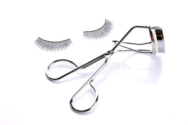 Fake false eyelash with curler. Fashion fake false eyelash with curler isolated on white background stock image
