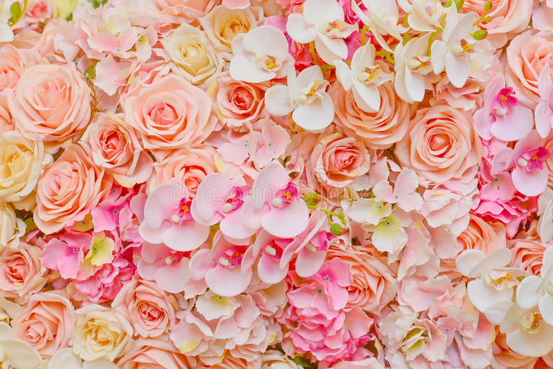 Fake flowers of beautiful pink roses and orchids for wedding. Decoration or background of your work stock photography
