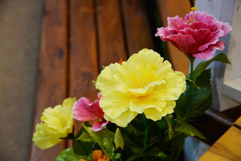 Fake Flowers Bouquet On Wallpaper Background Stock Photo - Image of ...