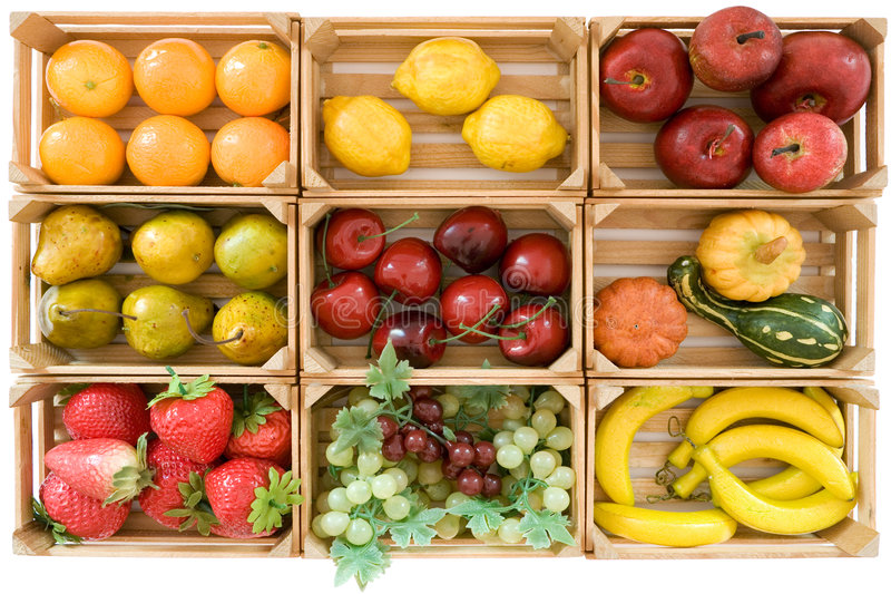 Fake Fruits. Wooden baskets with various toy fruits. Isolated on a white background stock image