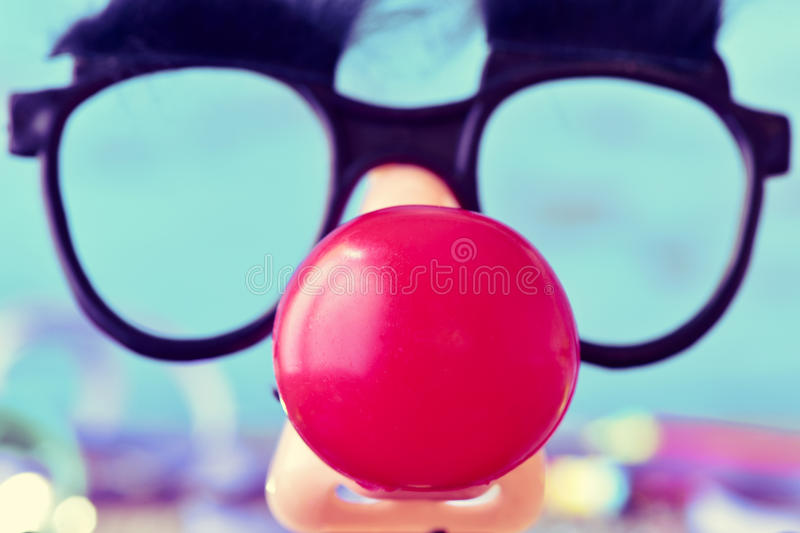 Fake glasses and clown nose stock image