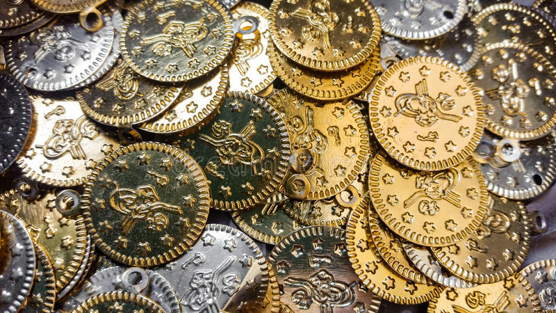 Fake gold and silver coins closeup. Fake gold and silver coins stock photography