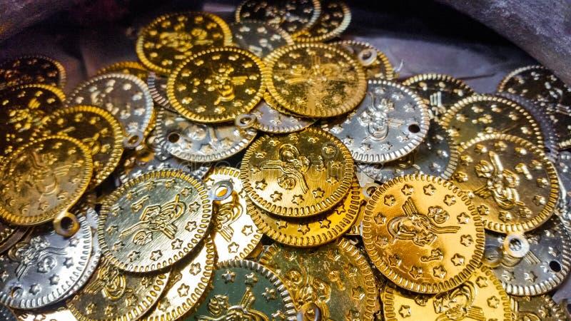 Fake gold and silver coins closeup. Fake Ottoman gold and silver coins closeup stock images