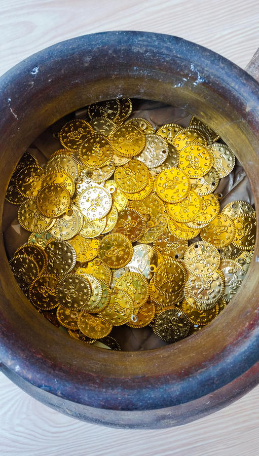 Fake gold and silver coins in earthenware jar. Fake Ottoman gold and silver coins in earthenware jar stock images